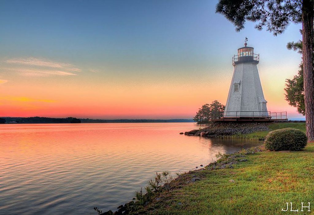 lighthouse at sunset on the lake